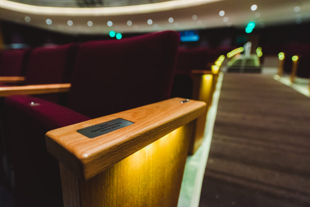 A close up shot of a seat in the Wilson Center performance hall